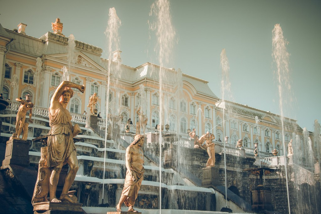 Beautiful scene of the famous fountains in front of the royal Peterhof in summer